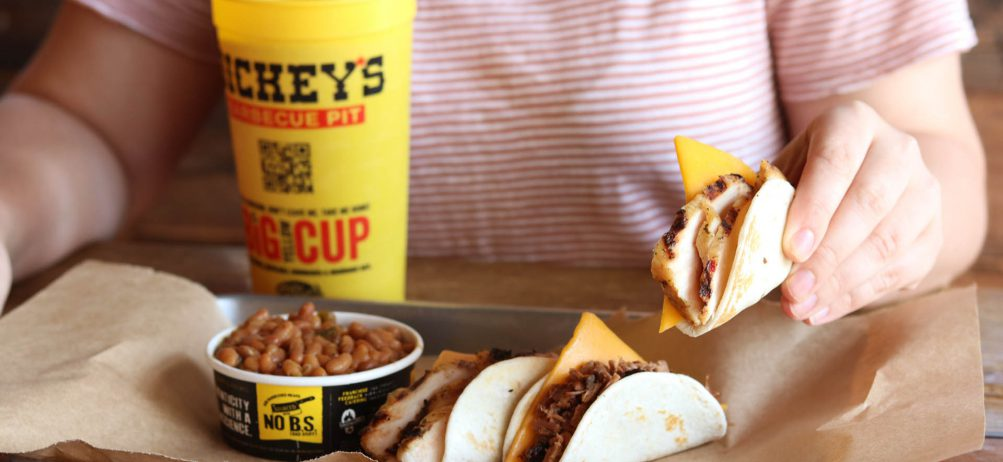 Roland Dickey Stops by New Dickey's Barbecue Pit in Seaside
