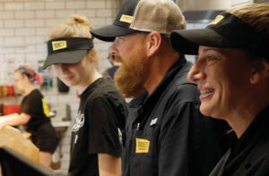dickey's barbecue pit franchise employees laughing in kitchen